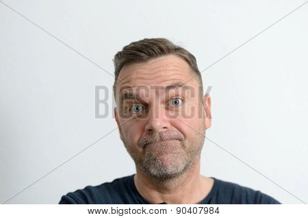 Speechless Middle-aged Man Looking At Camera
