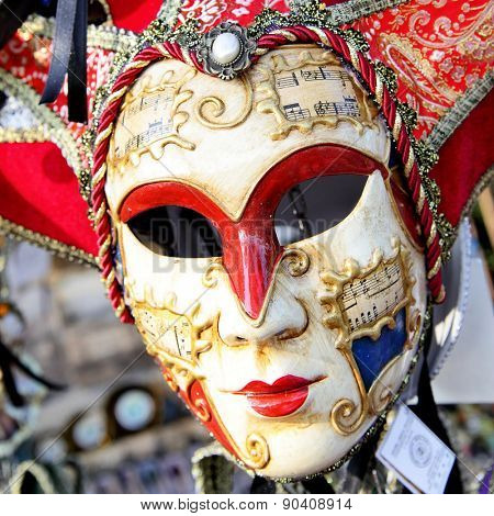 VENICE, ITALY - OCTOBER 02, 2013: Traditional venice mask (Harlequin) at market stall