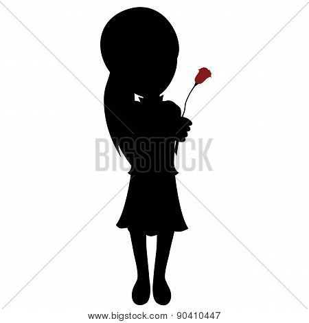 Silhouette of a little girl with a rose