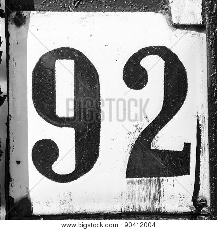 Old Scratched Metal Plate With The Number Ninety-two
