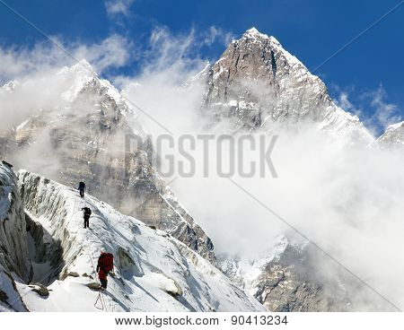Group Of Climbers On Mountains Montage To Mount Lhotse