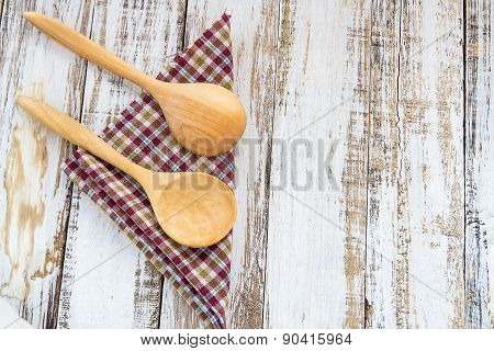Wooden Spoons On Checkered Cloth Lying On Wooden Surface
