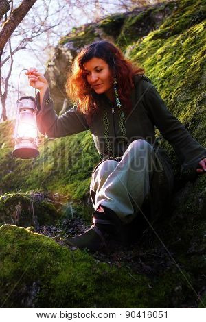 Fantasy Beautiful Woman With Color Light Lamps In The Moss Rocks