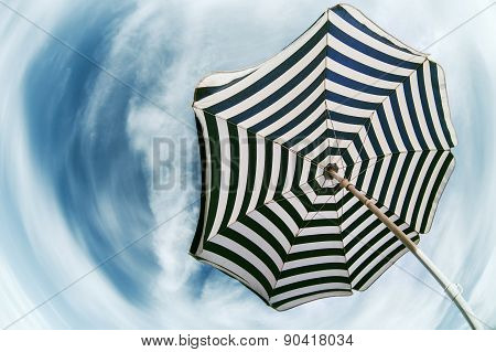 Striped  Beach Umbrella Over Blue Sky Fish Eye View
