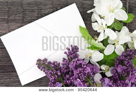 Spring Apple Tree Blossom And Lilac On Rustic Wooden Background With Empty Card For Greeting Message