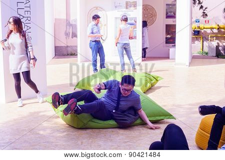 Young Man On Green Pouf