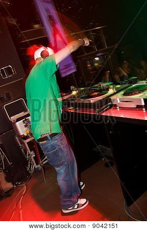 Dj Playing Turntable In The Club
