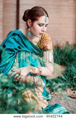 The Girl In The Blue Indian Costume.