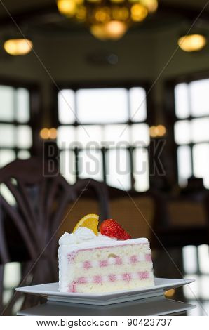 Piece Of Pie With Pudding Cream And Ripe Strawberries And Orange On A Plate