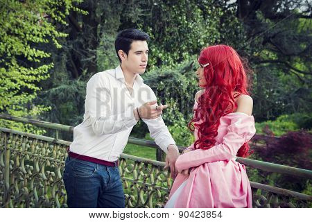 Romantic Fairy Tale Couple Standing on Balcony
