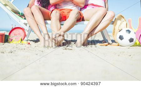 Three Friends Sitting On A Beach Deck