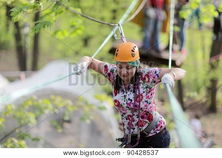 Person Climbing At Adventure Park