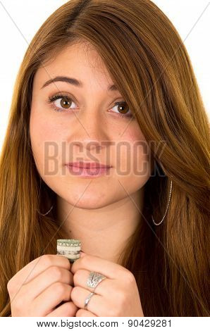 Beautiful superstitious woman holding a dollar bill