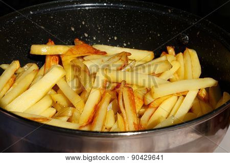Roasted Potato Chips In A Metal Frying Pan