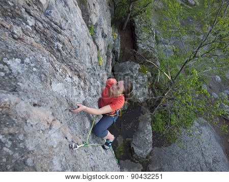 Purposeful Young Girl Climbs Up.