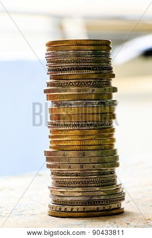 macro view of coins stacked on a blurred background