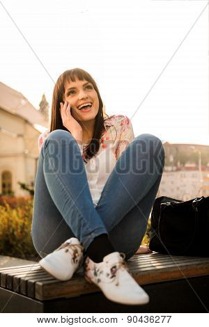 Woman on a phone in street