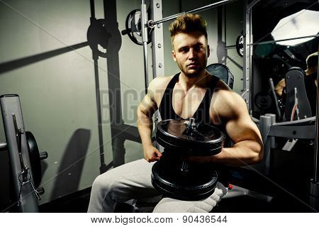 Strong Bodybuilder Athlete With Heavy  Dumbbells In Gym