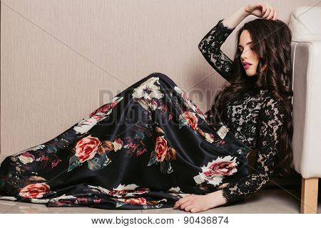 beautiful young brunette woman with long hair lying