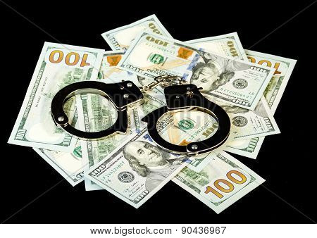 Handcuffs on dollar bills