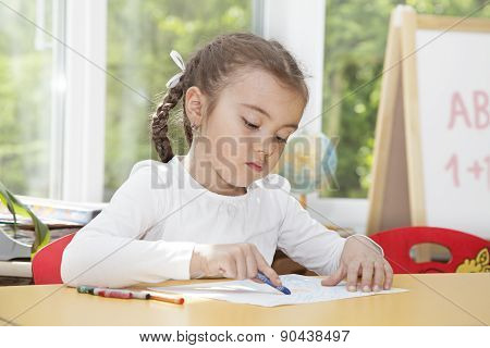 Caucasian Little Girl Drawing With Pencils