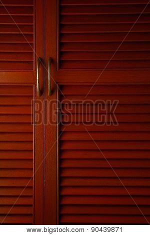 Wooden cabinet door with metal handle