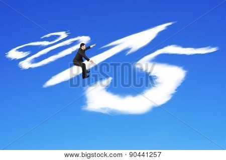 Man Riding 2015 Arrow Up Shape Clouds In Blue Sky