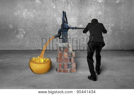 Man Drawing Golden Sand Currency Symbols Retro Pump Concrete Room