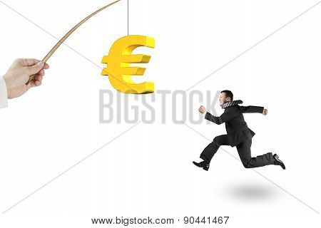 Man Running Golden Euro Symbol Fishing Lure Isolated On White