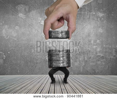 Hand Stacking Concrete Blocks Man Carrying On Wood Floor
