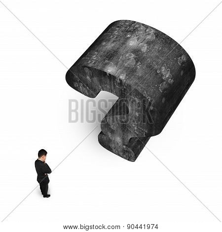 Man Thinking With Huge 3D Concrete Question Mark White Background