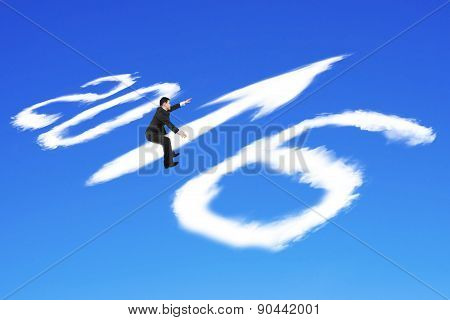 Man Riding 2016 Arrow Up Shape Clouds In Blue Sky