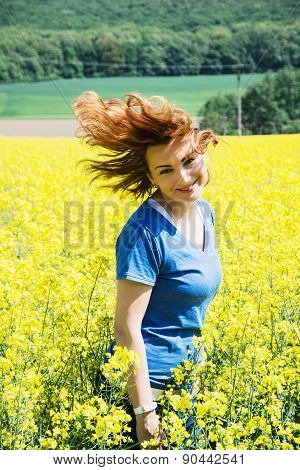 Happy Young Woman In Rapeseed Field