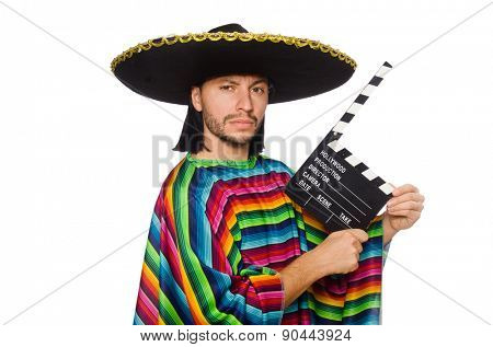 Handsome man in vivid poncho holding clapperboard isolated on white