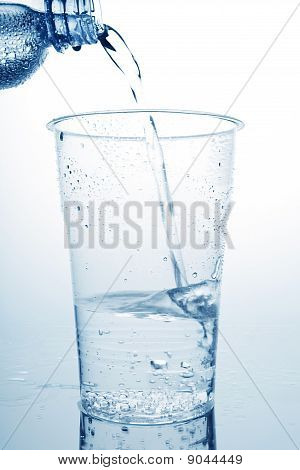 Water Pouring In Plastic Cup