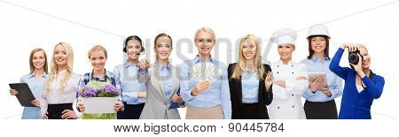 people, profession, employment, compensation and finances concept - happy businesswoman holding dollar money over group of professional workers