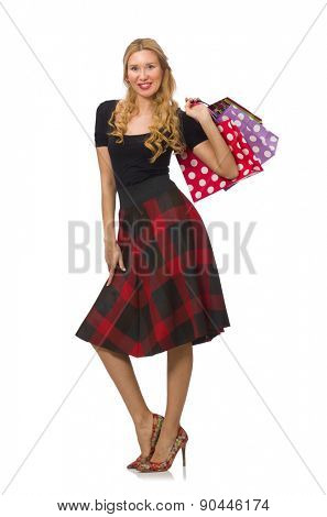 Beautiful young woman in plaid dress isolated on white