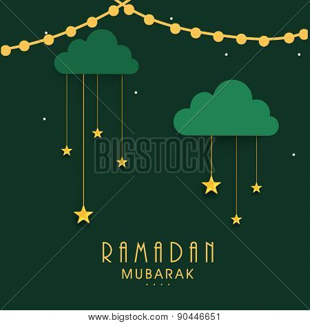 Islamic holy month of prayers, Ramadan Mubarak celebrations concept with hanging golden stars on green background.
