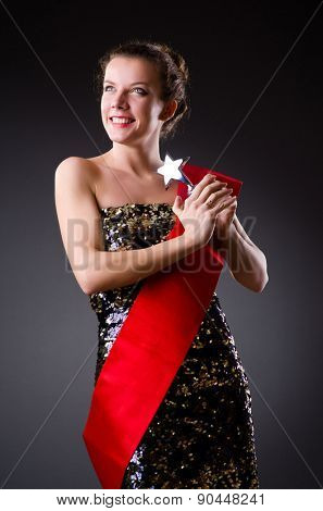 Woman winning the beauty contest