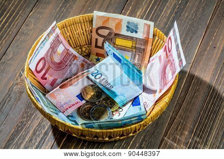 a basket with money for donations and gratuities