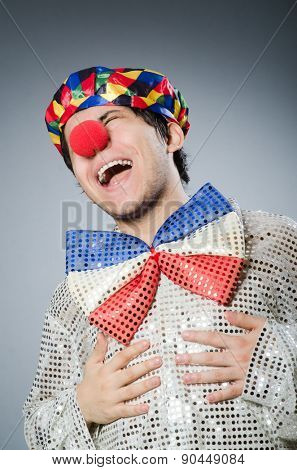 Funny clown against dark background
