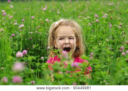Cute little girl on the meadow in spring day.  Freedom concept.