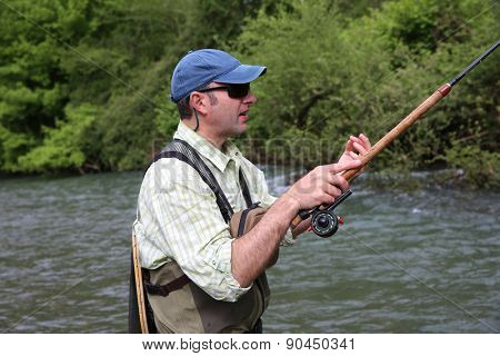 Fisherman with fishing line in river