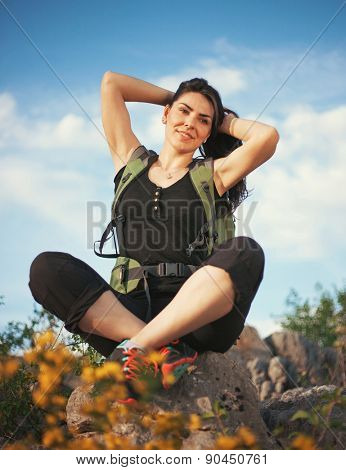 Woman hiking in beautiful nature, back light by morning sunlight rays, recreation and healthy lifestyle outdoors in wild. Hiker backpacker walking on mountain top.
