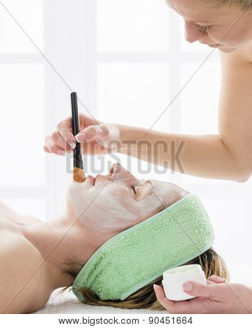 Woman on cosmetics treatment
