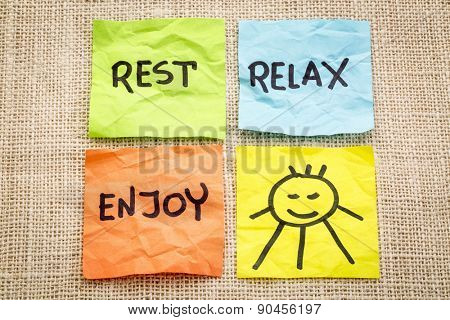 rest, relax and enjoy - words on sticky notes with a smiling sun