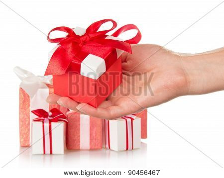 Present boxes and female hand with gift