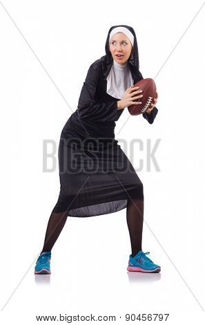Pretty nun with rugby ball isolated on white