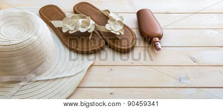 beach accessories on a white wooden background