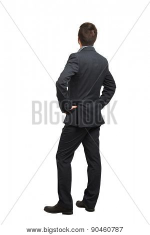 back view of man in formal wear looking up. isolated on white background